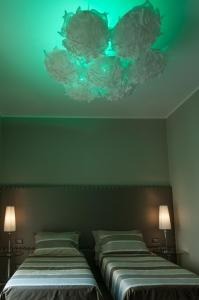 A bed or beds in a room at Brera Prestige B&B