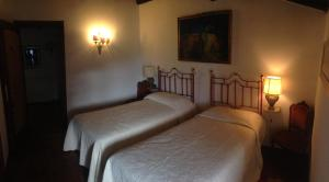 A bed or beds in a room at B&B Castel Ivano