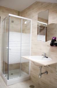 Un baño de Apartamentos Alday