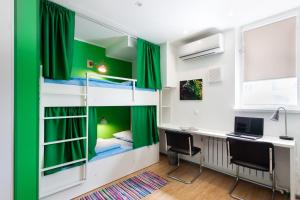 A bunk bed or bunk beds in a room at Hostel Kvartira 31