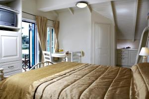 A bed or beds in a room at Dafnoudi Hotel Apartments
