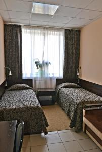 A bed or beds in a room at Perekrestok Hotel