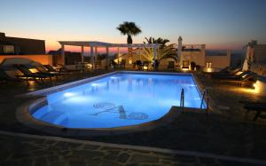 The swimming pool at or near Aethrio Sunset Village - Oia