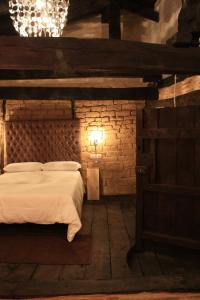 A bed or beds in a room at Priorato del Val