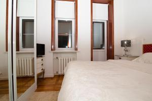 Кровать или кровати в номере Бизнес-Апартаменты Кутузовский 35