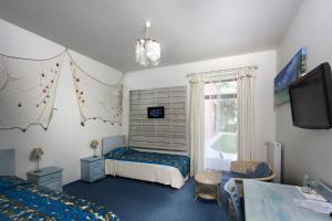 Un ou plusieurs lits dans un hébergement de l'établissement Hotel Pałac Nieznanice