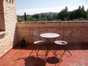Un balcón o terraza de Casa Del Olivar