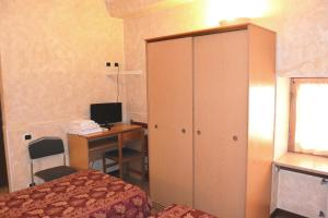 A television and/or entertainment center at Hotel Nettuno