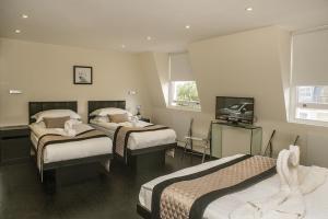 Letto o letti in una camera di NOX HOTELS - Notting Hill