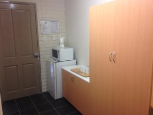 A kitchen or kitchenette at Budget Motel