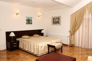 Кровать или кровати в номере Apartmani Marbis