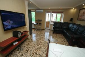 A television and/or entertainment center at Pechersk Apartment in Kiev Center