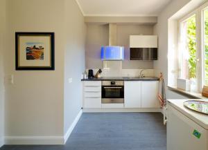 Küche/Küchenzeile in der Unterkunft Ferienwohnung Glückspilz