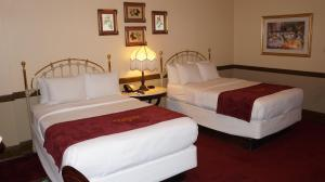 A bed or beds in a room at Stockyards Hotel