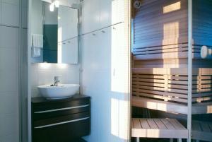 Ett badrum på Jugend Home Hotel