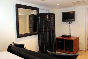 A television and/or entertainment center at COMFY Lower Level 2 Bdrm Home