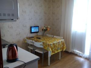Кухня или мини-кухня в Апартаменты Allinrent Химки