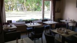 Een restaurant of ander eetgelegenheid bij Kokodor