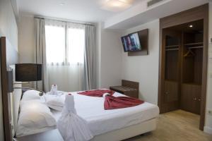A bed or beds in a room at El Mudayyan
