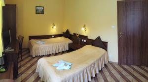 Łóżko lub łóżka w pokoju w obiekcie Pokoje Gościnne Akacja