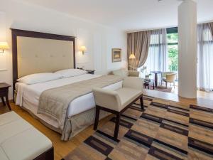 Ein Bett oder Betten in einem Zimmer der Unterkunft Park Hotel Principe