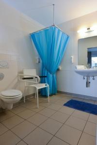 Ein Badezimmer in der Unterkunft Hotel Aan Zee