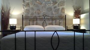 Ένα ή περισσότερα κρεβάτια σε δωμάτιο στο Villa Del Lago Boutique Hotel