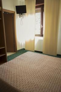 Letto o letti in una camera di Albergo La Romanella