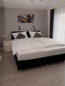 Een bed of bedden in een kamer bij Schelvis Apartments