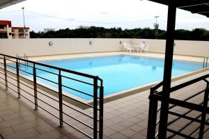 The swimming pool at or near Riverside Residence by Gina Suite