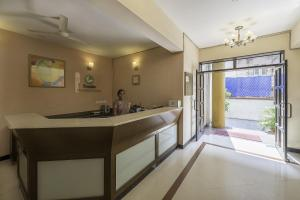 The lobby or reception area at Orchard Suites