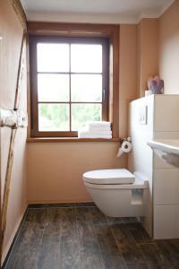 Ein Badezimmer in der Unterkunft Pension Alte Schmiede