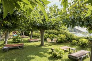 A garden outside Rigat Park & Spa Hotel