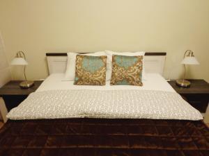 Łóżko lub łóżka w pokoju w obiekcie Rental Apartments Żurawia