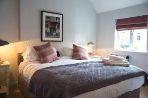 A bed or beds in a room at The Pheasant at Neenton