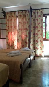 Ένα ή περισσότερα κρεβάτια σε δωμάτιο στο Ξενοδοχείο Βίλλα Όρσα