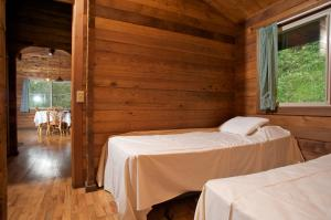 A bed or beds in a room at The Cabins at Kokee