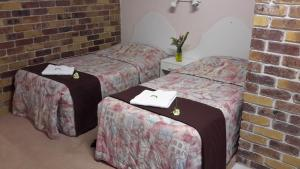 A bed or beds in a room at Nimbin Rocks Retreat