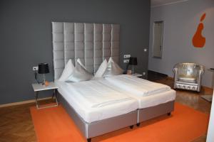 Ein Bett oder Betten in einem Zimmer der Unterkunft Stadthotel Gürtler