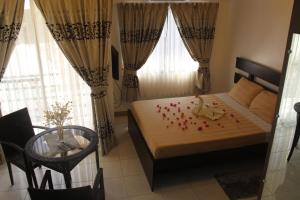 A bed or beds in a room at Anahaw Studio Suites