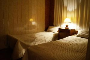 A bed or beds in a room at Cottages in Repino