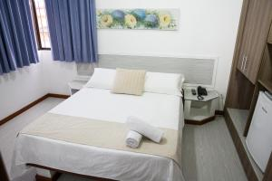 Cama o camas de una habitación en Mar de Canasvieiras Hotel e Eventos