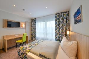 Ein Bett oder Betten in einem Zimmer der Unterkunft Ammi Hotel Garni