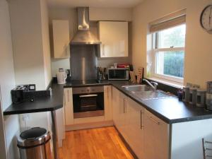 A kitchen or kitchenette at Bath Breaks Apartments