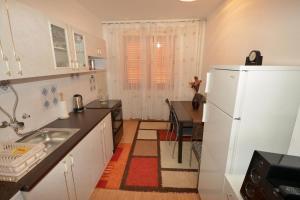 Kuchyň nebo kuchyňský kout v ubytování Sole Mio Apartment
