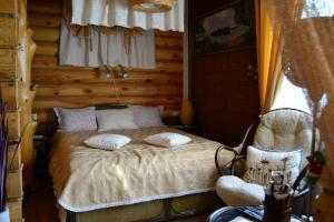 Кровать или кровати в номере Uyutniy Dom Inn