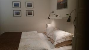 Ein Bett oder Betten in einem Zimmer der Unterkunft OESTER Bed by the Sea