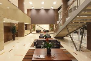 The lobby or reception area at Hotel Estelar Milla De Oro