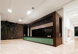 The lobby or reception area at Estelar Alto Prado