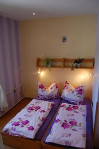 A bed or beds in a room at Penzion Eliska